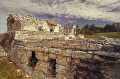 The magnificient Ruins of Tulum. Side view of the remains of a small Mayan temple in the Tulum complex in Mexico taken at sunset stock images