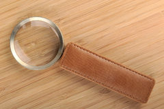 Magnifier against a background of bamboo Stock Image
