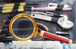 Magnifier against a tooling Stock Photo