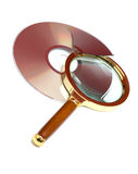 Magnifier And Broken CD Stock Images