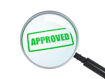 Magnifier with approved stamp Royalty Free Stock Photo