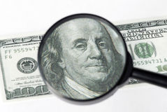 Magnifier on banknote Stock Photo