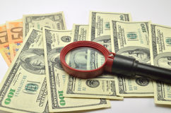 Magnifier on banknotes Royalty Free Stock Photography