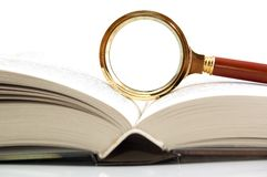 Magnifier and the book Stock Image