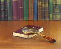 Magnifier and book Royalty Free Stock Photography
