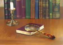 Magnifier and book Stock Photography
