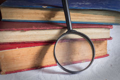 Magnifier with books,education background Royalty Free Stock Photography