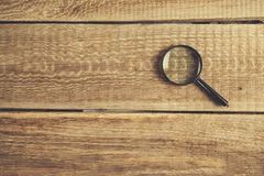 Magnifier on desk royalty free stock photography
