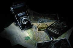 Magnifier, camera and map Royalty Free Stock Photography
