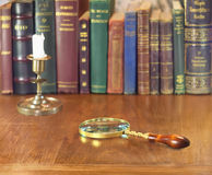 Magnifier and candlestick Royalty Free Stock Image
