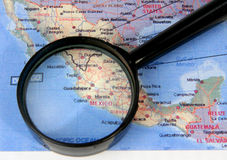 Magnifier on a card of Mexico Stock Image