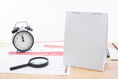 Magnifier and clock with business Calender Planner 2017 on desk office. Organization management remind concept Stock Images