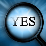 Magnifier  with closeup of. Magnifier with closeup of yes on a dark blue background Stock Images