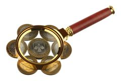 Magnifier and coins Royalty Free Stock Photos