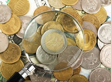Magnifier on coins Stock Photography