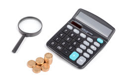 Magnifier,coins and calculator Stock Photo