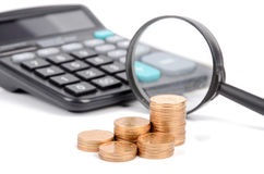 Magnifier,coins and calculator Royalty Free Stock Image