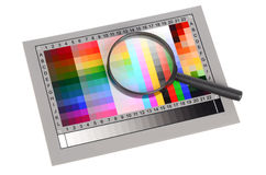 Magnifier and color card Royalty Free Stock Images