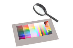 Magnifier and color card Royalty Free Stock Photo