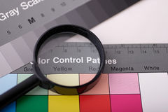 Magnifier on color chart. Calibration chart Stock Photos