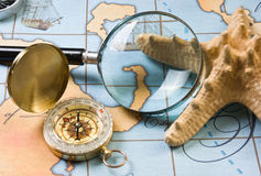 Magnifier and compass on  map Royalty Free Stock Photography