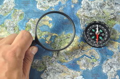 Magnifier,compass and map Stock Images