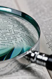Magnifier and dictionary Stock Images