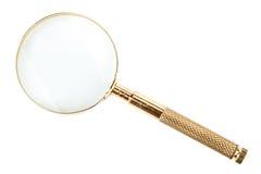 Magnifier do ouro Imagem de Stock Royalty Free