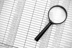 Magnifier and documents. Information search. Stock Photos
