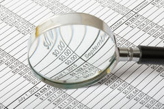 Magnifier with documents Royalty Free Stock Image