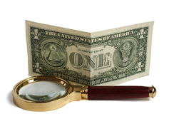 Magnifier and dollar Royalty Free Stock Photo