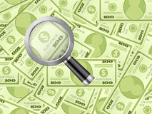 Magnifier on dollar background Stock Photo