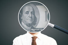 Magnifier with dollar on businessman. Businessman with dollar banknote inside magnifying glass instead of head on grey background. 3D Rendering Royalty Free Stock Image