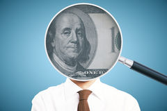 Magnifier with dollar head. Businessman with dollar banknote inside magnifying glass instead of head on blue background. 3D Rendering Stock Photography