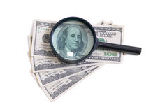 Magnifier with dollars Royalty Free Stock Photo