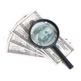 Magnifier with dollars Royalty Free Stock Image