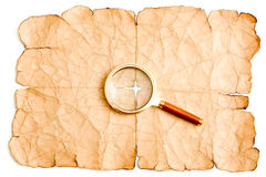 Magnifier e papel velho Fotos de Stock Royalty Free