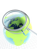 Magnifier and earth Stock Photos