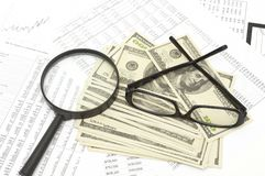 Magnifier and economy newspaper Royalty Free Stock Photo