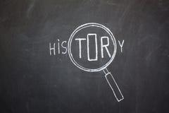 Magnifier en 'Geschiedenis' woord Stock Foto's