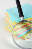 Magnifier enlarges the stack of sheets Royalty Free Stock Photo
