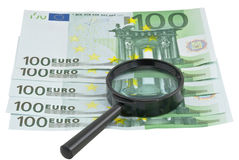 Magnifier with euro Stock Images