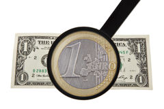 Magnifier, euro and dollar Royalty Free Stock Photos