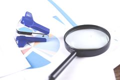 Magnifier on the finance graph paper background stock photo