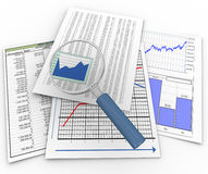 Magnifier on financial documents Stock Images