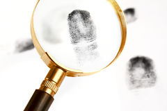 Magnifier and finger-print Royalty Free Stock Photos