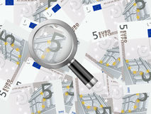 Magnifier on five euro background Stock Photos
