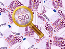 Magnifier on five hundred euro background Stock Photo