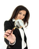 Magnifier glass. Portrait of young business woman looking through a magnifier glass isolated over white background Royalty Free Stock Photo