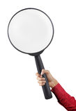Magnifier glass. Hand in red suit holding a big magnifier glass Stock Image